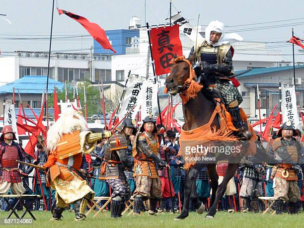 Yonezawa Japan People reenact one of the famous Battles of Kawanakajima between rival warlords Uesugi Kenshin and Takeda Shingen in the mid16th...