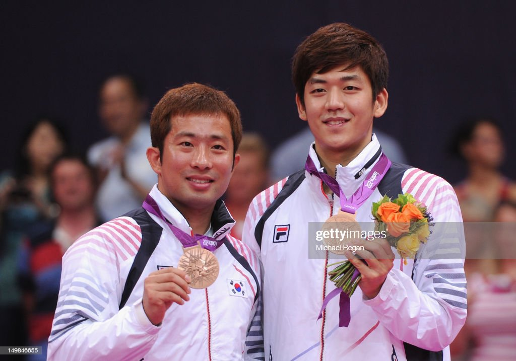 Yong Dae Lee and Jae Sung Chung of Korea (L) stand with their Bronze medals following the Men's Doubles Badminton Gold Medal match on Day 9 of the London 2012 Olympic Games at Wembley Arena on August 5, 2012 in London, England.