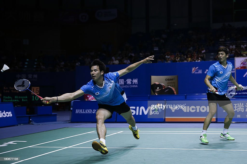 Yong Dae Lee (R) and Sung Hyun Ko of South Korea compete in the men's doubles final match against Kenichi Hayakawa and Hiroyuki Endo of Japan on day 6 of the 2013 China Badminton Masters at Changzhou Olympic Sports Center on September 15, 2013 in Changzhou, China.