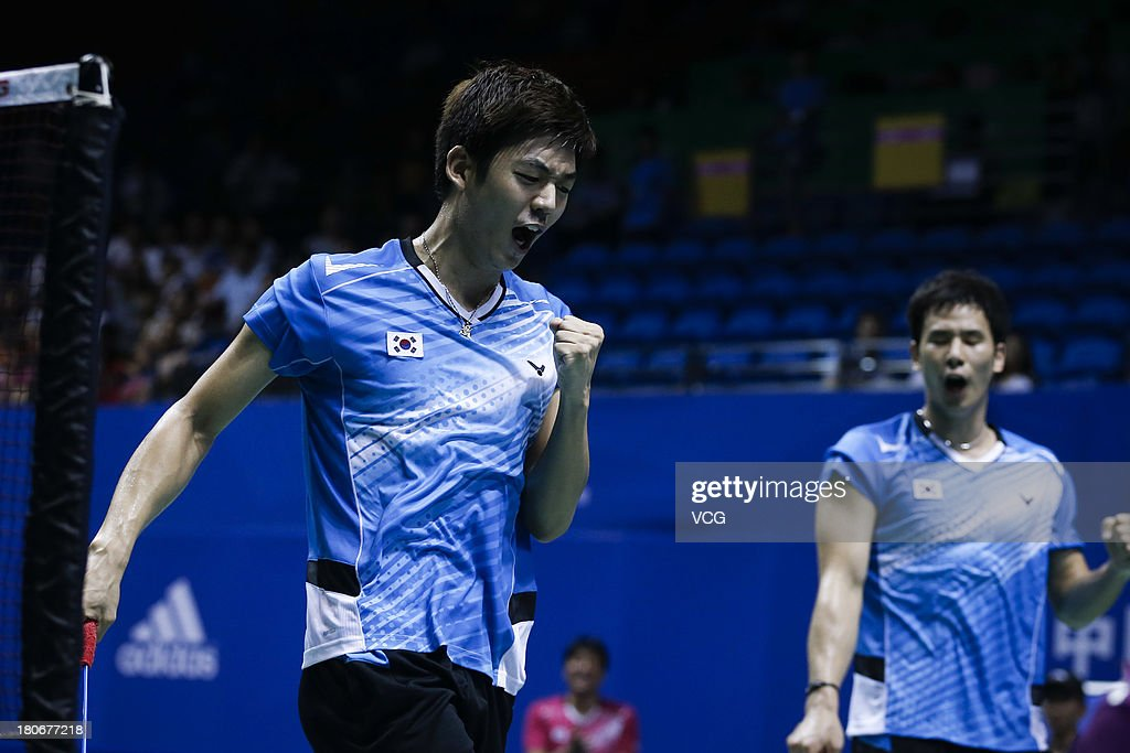Yong Dae Lee (L) and Sung Hyun Ko of South Korea compete in the men's doubles final match against Kenichi Hayakawa and Hiroyuki Endo of Japan on day 6 of the 2013 China Badminton Masters at Changzhou Olympic Sports Center on September 15, 2013 in Changzhou, China.