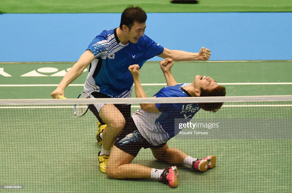 Yong Dae Lee and team mate Yeon Seong Yoo of Korea celebrate victory over Mohammad Ahsan and Hendra Setiawan of Indonesia during day six of Badminton YONEX Open on June 15, 2014 in Tokyo, Japan.