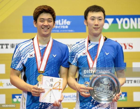 Yong Dae Lee and team mate Yeon Seong Yoo of Korea celebrate with the gold medal on the podium during day six of Badminton YONEX Open on June 15 2014...
