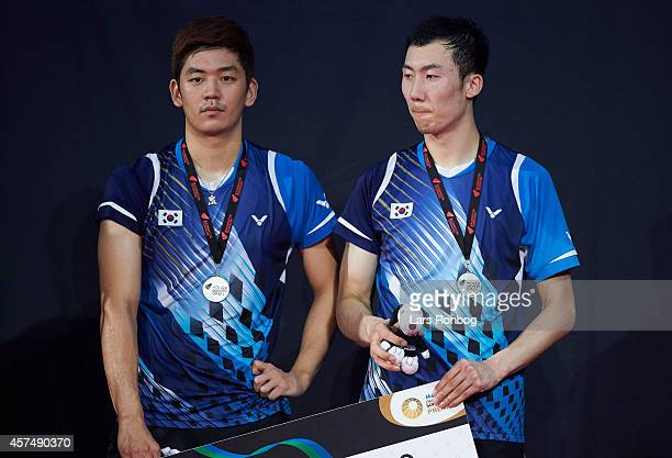 Yong Dae Lee and Yeon Seong Yoo of Korea on the podium receiving silver medals after the Mens Double final during the Yonex Denmark Open MetLife BWF...