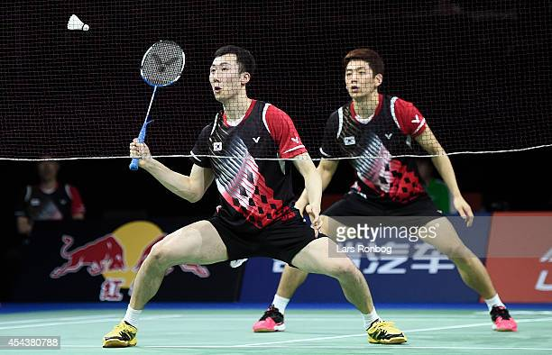 Yong Dae Lee and Yeon Seong Yoo of Korea playing against Mathias Boe and Carsten Mogensen of Denmark in the semifinals during the LiNing BWF World...