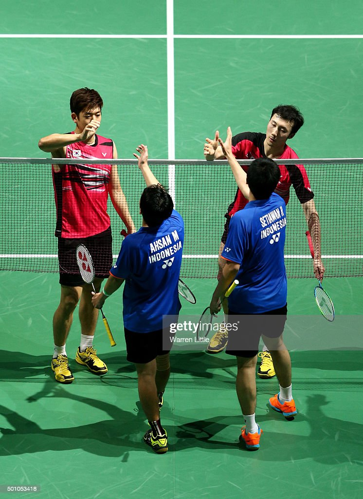 Yong Dae Lee and Yeon Seong Yoo of Korea shake hands with Mohammad Ahsan and <a gi-track='captionPersonalityLinkClicked' href=/galleries/search?phrase=Hendra+Setiawan&family=editorial&specificpeople=2237241 ng-click='$event.stopPropagation()'>Hendra Setiawan</a> of Indonesia in the Men's Doubles semi final match during day four of the BWF Dubai World Superseries 2015 Finals at the Hamdan Sports Complex on December 12, 2015 in Dubai, United Arab Emirates.