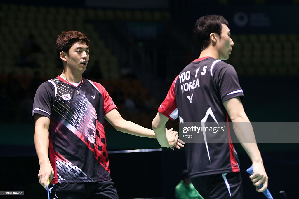 Yong Dae Lee (L) and Yeon Seong Yoo of South Korea react in the Men's Double match against Wang Yilv and Zhang Wen of China on day two of the BWF 2014 Thaihot China Open at Haixia Olympic Sport Center on November 12, 2014 in Fuzhou, Fujian province of China.