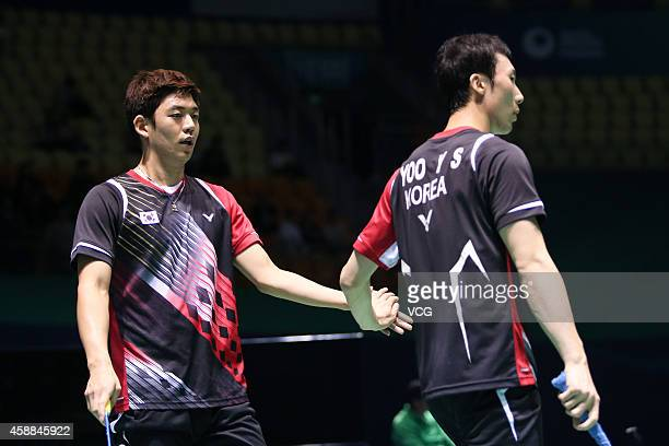 Yong Dae Lee and Yeon Seong Yoo of South Korea react in the Men's Double match against Wang Yilv and Zhang Wen of China on day two of the BWF 2014...