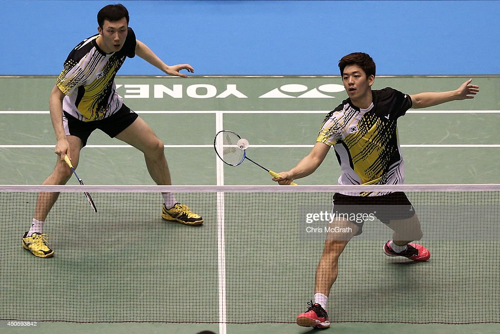 Yong Dae Lee of Korea returns a shot as team mate Yeon Seong Yoo watches on during their Men's Doubles semi final match against Angga Pratama and Ryan Agung Saputra of Indonesia on day five of the Badminton YONEX Open on June 14, 2014 in Tokyo, Japan.