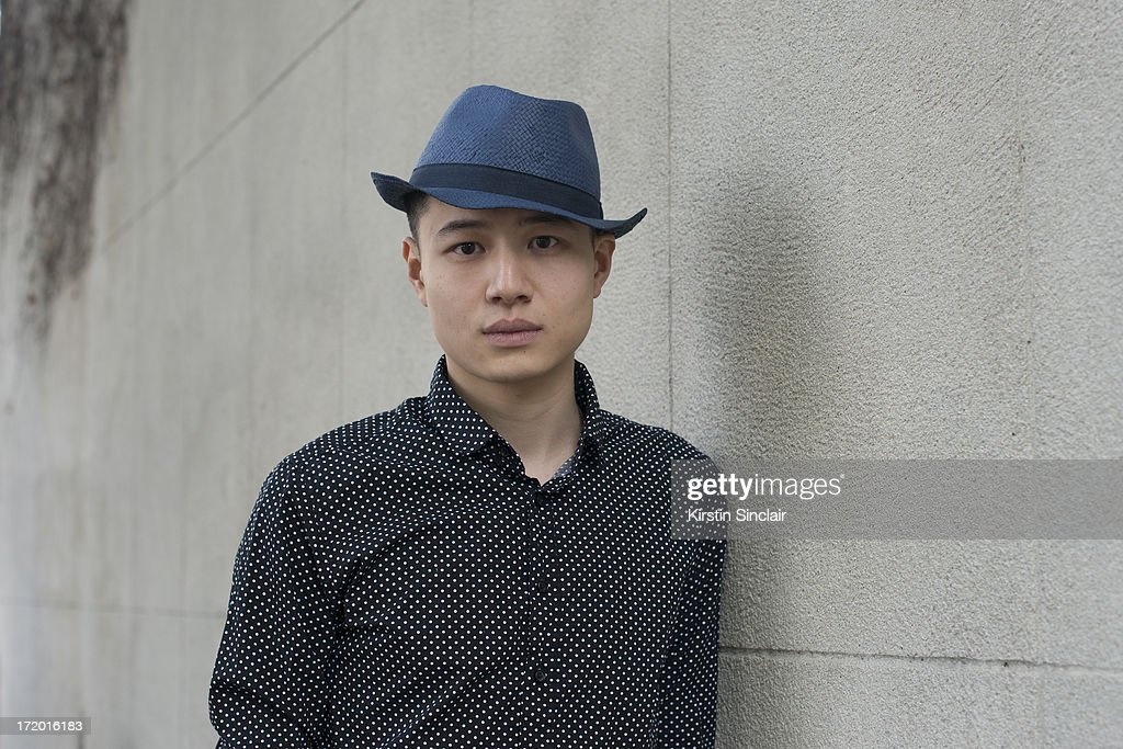 Yong Hao Yu wears Zara hat and a Tom Lee shirt on day 4 of Paris Collections: Men on June 29, 2013 in Paris, France.