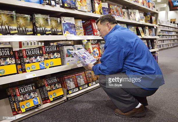 Yong Kwon shops for computer software at a Best Buy store November 7 2003 in Skokie Illinois The Bureau of Labor Statistics of the US Department of...