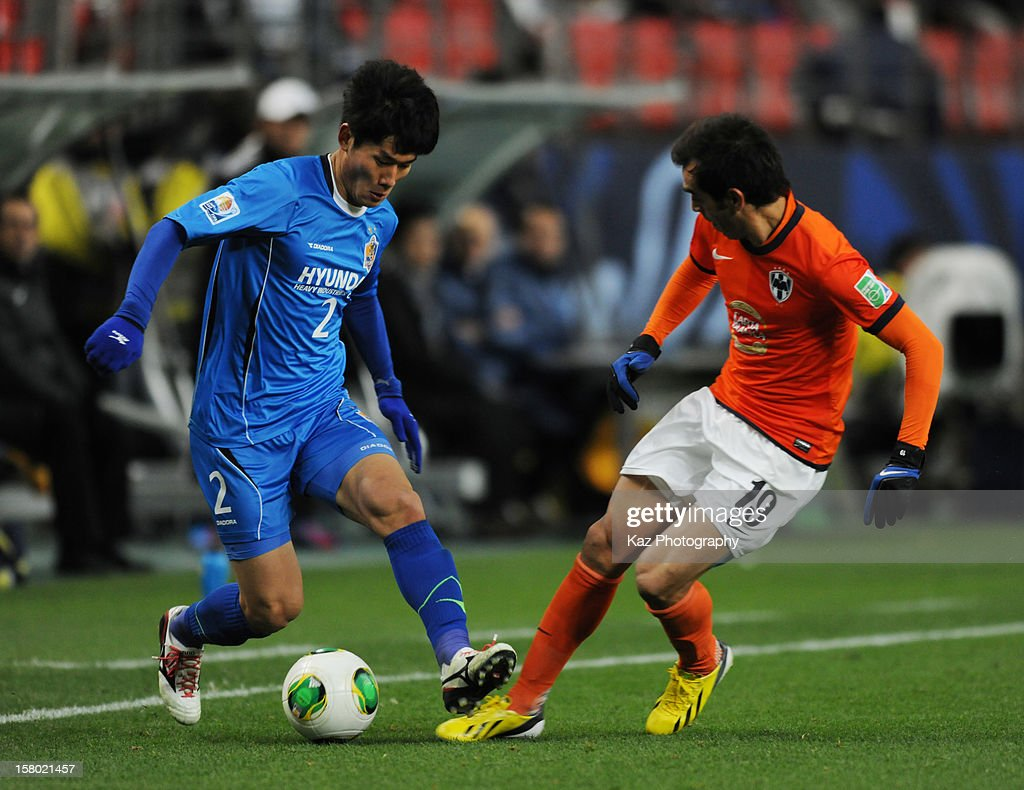Yong Lee of Ulsan Hyundai keeps the ball under the pressure from <a gi-track='captionPersonalityLinkClicked' href=/galleries/search?phrase=Cesar+Delgado&family=editorial&specificpeople=675597 ng-click='$event.stopPropagation()'>Cesar Delgado</a> of CF Monterrey during the FIFA Club World Cup Quarter Final match between Ulsan Hyundai and CF Monterrey at Toyota Stadium on December 9, 2012 in Toyota, Japan.