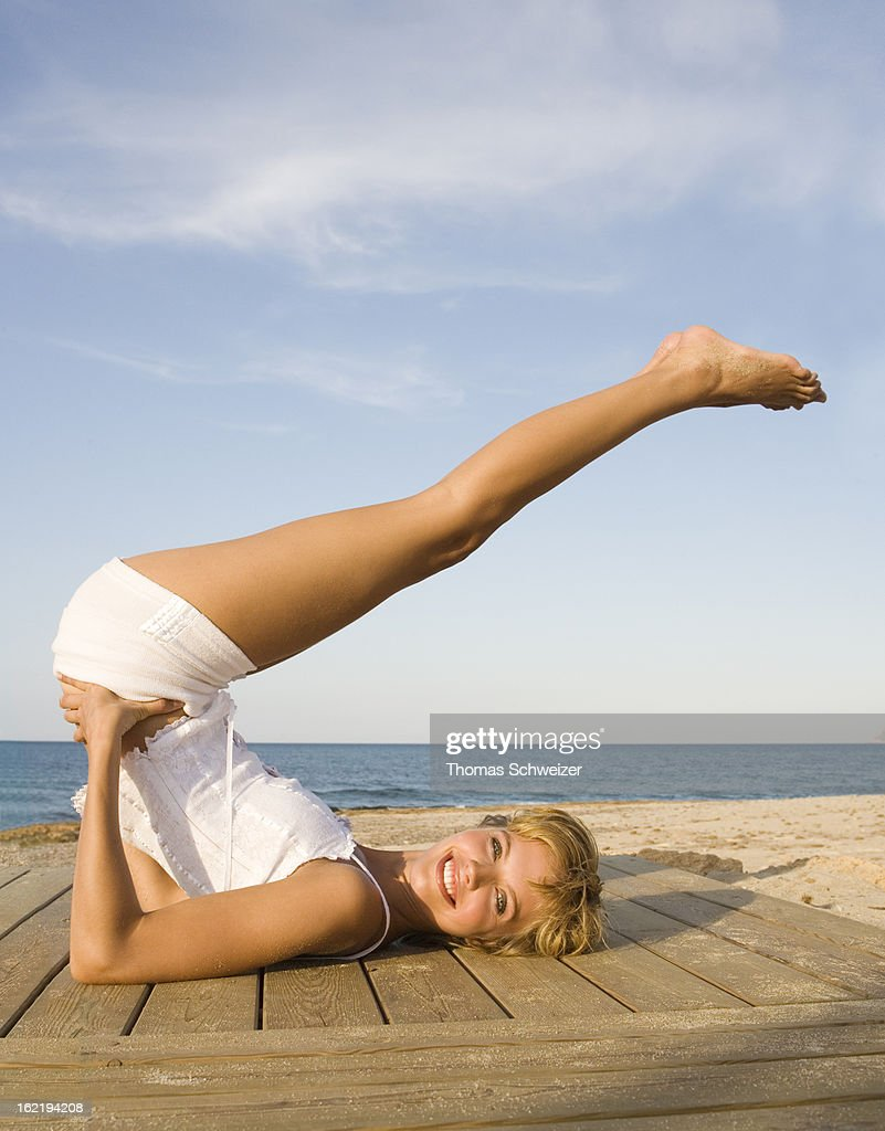 A yong woman exercising by the beach