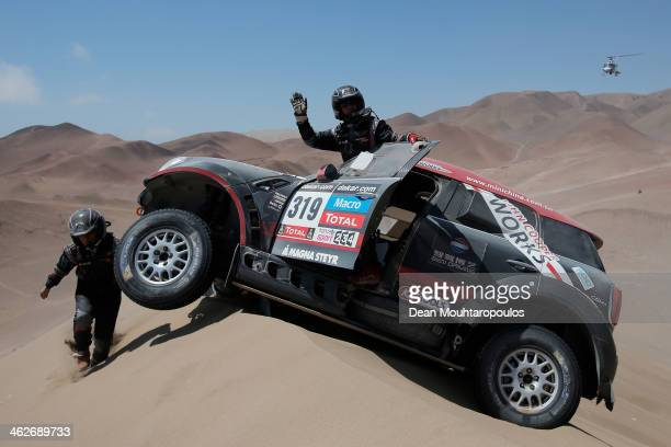 Yong Zhou and Hong Yu Pan of China for the MINI XRaid Team get stuck at the top of a dune in stage 9 during Day 10 of the 2014 Dakar Rally on January...