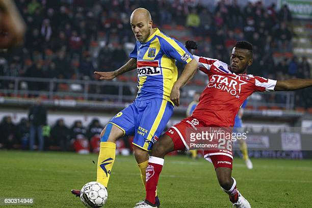 Yoni Buyens midfielder of KVC Westerlo and Aristote Nkaka defender of Royal Excel Mouscronduring the Jupiler Pro League match between Royal Excel...