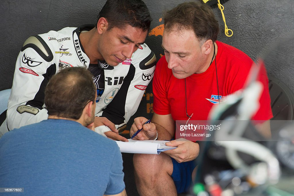 Yonny Hernandez of Colombia and Paul Bird Motorsport speaks with mechanics in box during day one of MotoGP Tests at Sepang Circuit on February 26, 2013 in Kuala Lumpur, Malaysia.