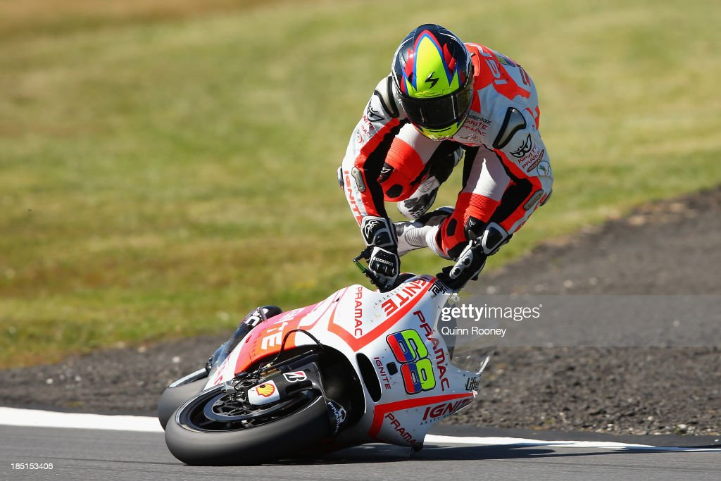 Yonny Hernandez of Colombia crashes his Ignite Pramac Racing Ducati during MotoGP free practice at Phillip Island Grand Prix Circuit on October 18, 2013 in Phillip Island, Australia.