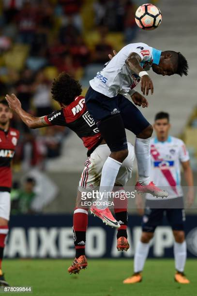 Yony Gonzalez of Colombia's Junior de Barranquilla jumps for a header with Willian Arao of Brazil's Flamengo during their Copa Sudamericana first leg...