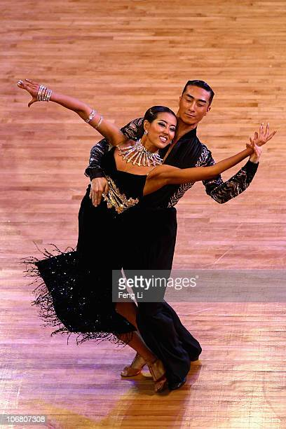 Yoo Hae Sook and Kim Dae Dong of South Korea complete in the Latin Five Dances Competition of the Dance Sports at the Zengcheng Gymnasium during day...