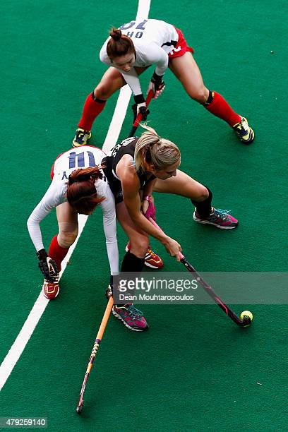 Yoo Jin Hong and Sunsoon Oh of Korea battle for the ball with Sophie Cocks of New Zealand during the Fintro Hockey World League SemiFinal match...