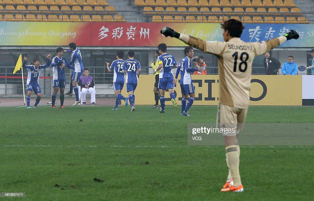 Yoo Jun-Soo #17 of Ulsan Hyundai celebrates with team mates after scoring his team's first goal during the AFC Asian Champions League match between Guizhou Renhe and Ulsan Hyundai at Guiyang Olympic Centre on April 1, 2014 in Guiyang, China.