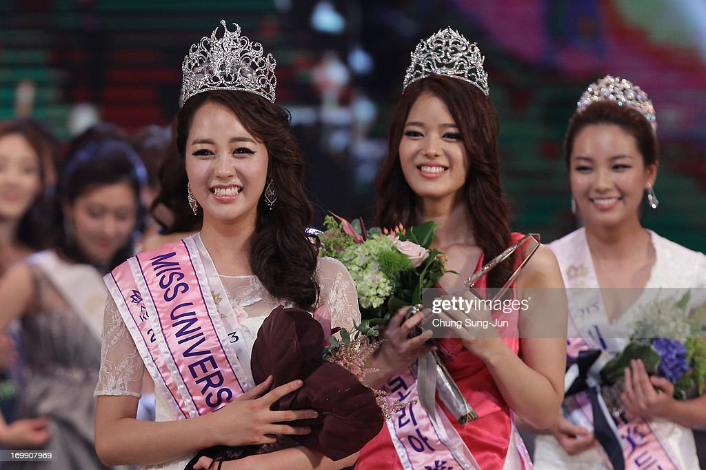 Yoo Ye-Bin (L) poses after winning the 2013 Miss Korea Beauty Pageant at Sejong Center on June 4, 2013 in Seoul, South Korea.