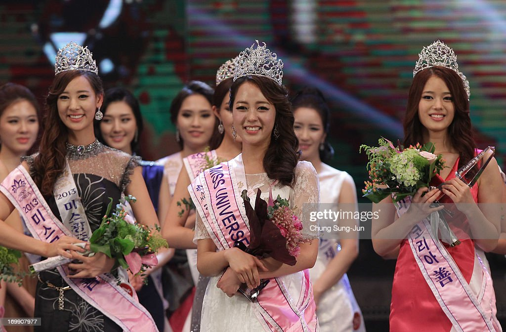 Yoo Ye-Bin (C) poses after winning the 2013 Miss Korea Beauty Pageant at Sejong Center on June 4, 2013 in Seoul, South Korea.