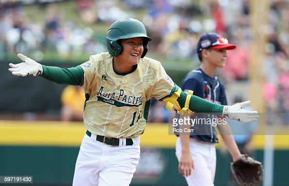 Yoomin Lee of the AsiaPacific team from South Korea celebrates after hitting a solo home run in the fifth inning against the MidAtlantic Team from...