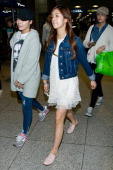 Yoon BoMi of South Korean girl group A Pink is seen upon arrival at Incheon International Airport on March 17 2013 in Incheon South Korea