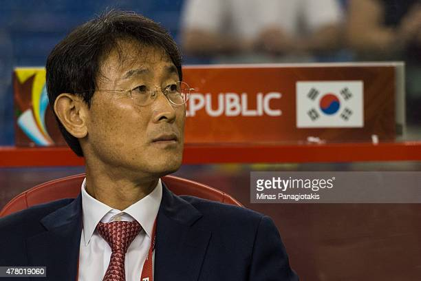 Yoon Dukyeo head coach of Korea Republic looks on during the 2015 FIFA Women's World Cup Round of 16 match against France at Olympic Stadium on June...
