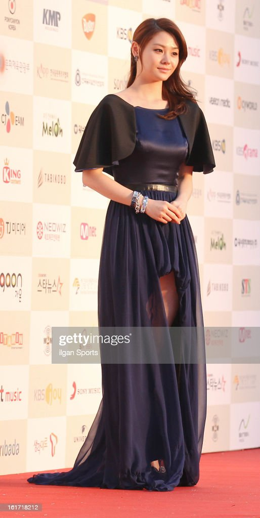 Yoon Joo poses for photographs upon arrival during '2nd Gaonchart K-pop Awards' at Olympic Hall on February 13, 2013 in Seoul, South Korea.