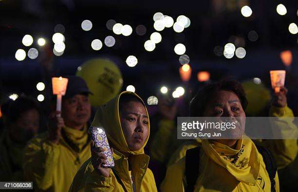 Yoon KyungHee mother of a Sewol ferry disaster victim and Danwon High School student Kim SiYeon attend the rally on April 25 2015 in Seoul South...