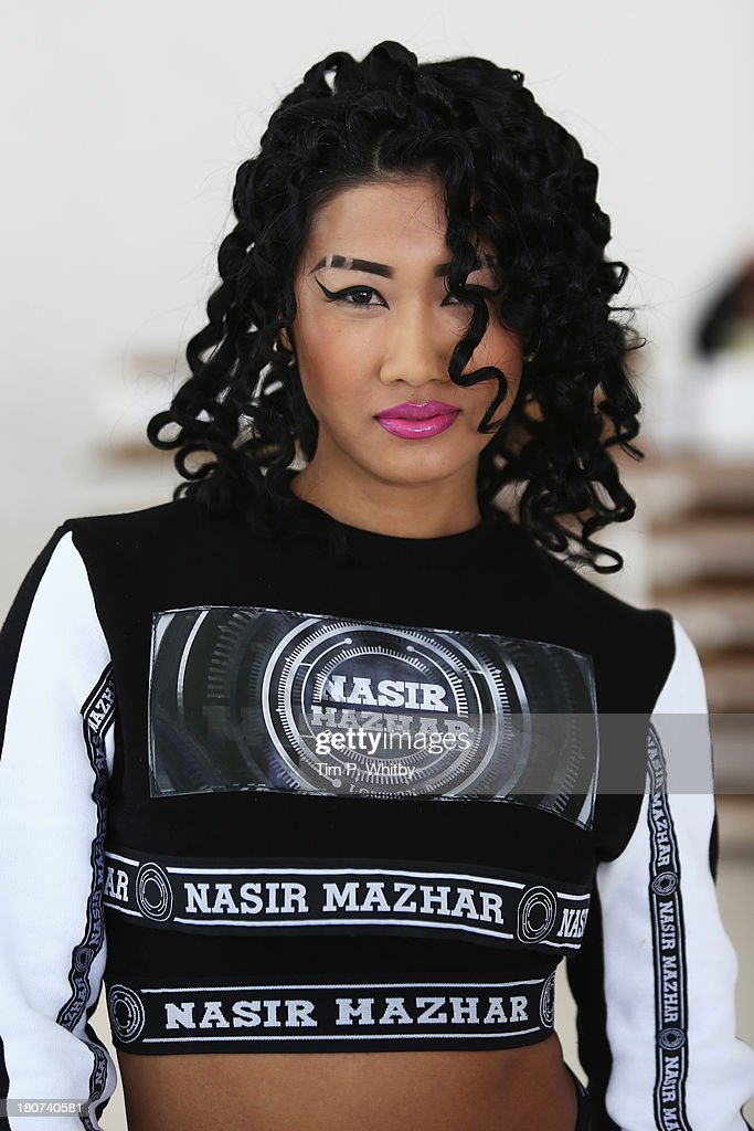 Yoon poses at the Nasir Mazhar presentation during London Fashion Week SS14 at TopShop Show Space on September 16, 2013 in London, England.