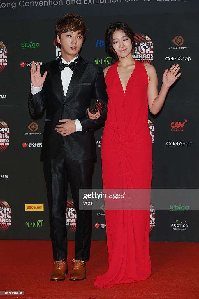 Yoon Si Yoon(L) and Park Shin-Hye arrive at the red carpet of the 2012 Mnet Asian Music Awards at Hong Kong Convention & Exhibition Center on November 30, 2012 in Hong Kong, China.