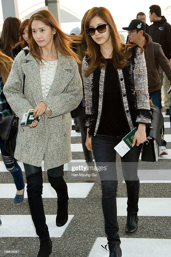 Yoona and Seohyun of South Korean girl group Girls' Generation is seen at Incheon International Airport on November 22, 2012 in Incheon, South Korea.