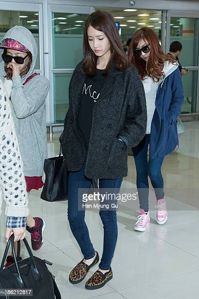Yoona of South Korean girl group Girls' Generation is seen upon arrival at the Gimpo Airport on October 28 2013 in Seoul South Korea