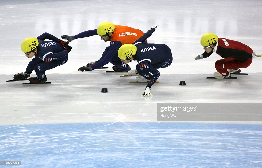 Yoon-Gy Kwak of Korea, Niels Kerstholt of Netherlands, Byeong-Jun Kim of Korea, Wenhao Liang of China compete in the Men's 1000m Final during the day one of the ISU World Cup Short Track at the Oriental Sports Center on December 8, 2012 in Shanghai, China.