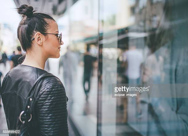 yooung woman looking at shop windows