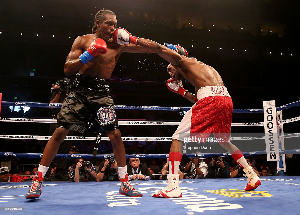 Yordens Ugas lands a punch on amir Imam in their super lightweight match at Galen Center on May 10, 2014 in Los Angeles, California. Stiverne won in a six round technical knockout.