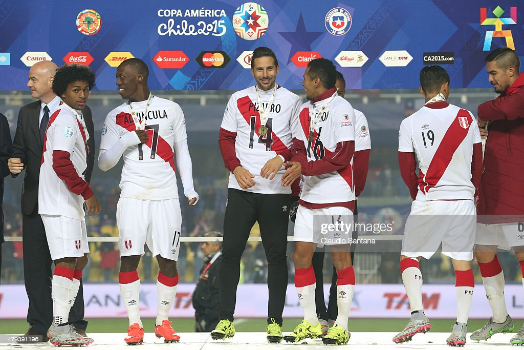 Yordy Reyna, Luis Advincula, <a gi-track='captionPersonalityLinkClicked' href=/galleries/search?phrase=Claudio+Pizarro&family=editorial&specificpeople=217807 ng-click='$event.stopPropagation()'>Claudio Pizarro</a>, Carlos Lobaton and Yoshimar Yotun of Peru celebrate with their third place medals after the 2015 Copa America Chile Third Place Playoff match between Peru and Paraguay at Ester Roa Rebolledo Stadium on July 03, 2015 in Concepcion, Chile.