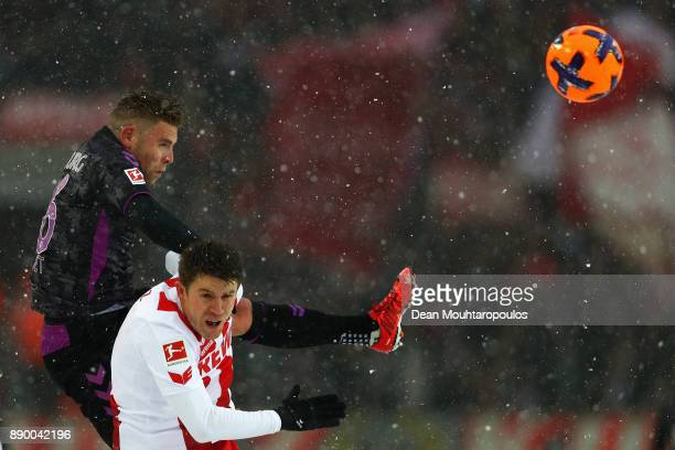 Yoric Ravet of SC Freiburg battles for the ball with Dominique Heintz of FC Koeln during the Bundesliga match between 1 FC Koeln and SportClub...