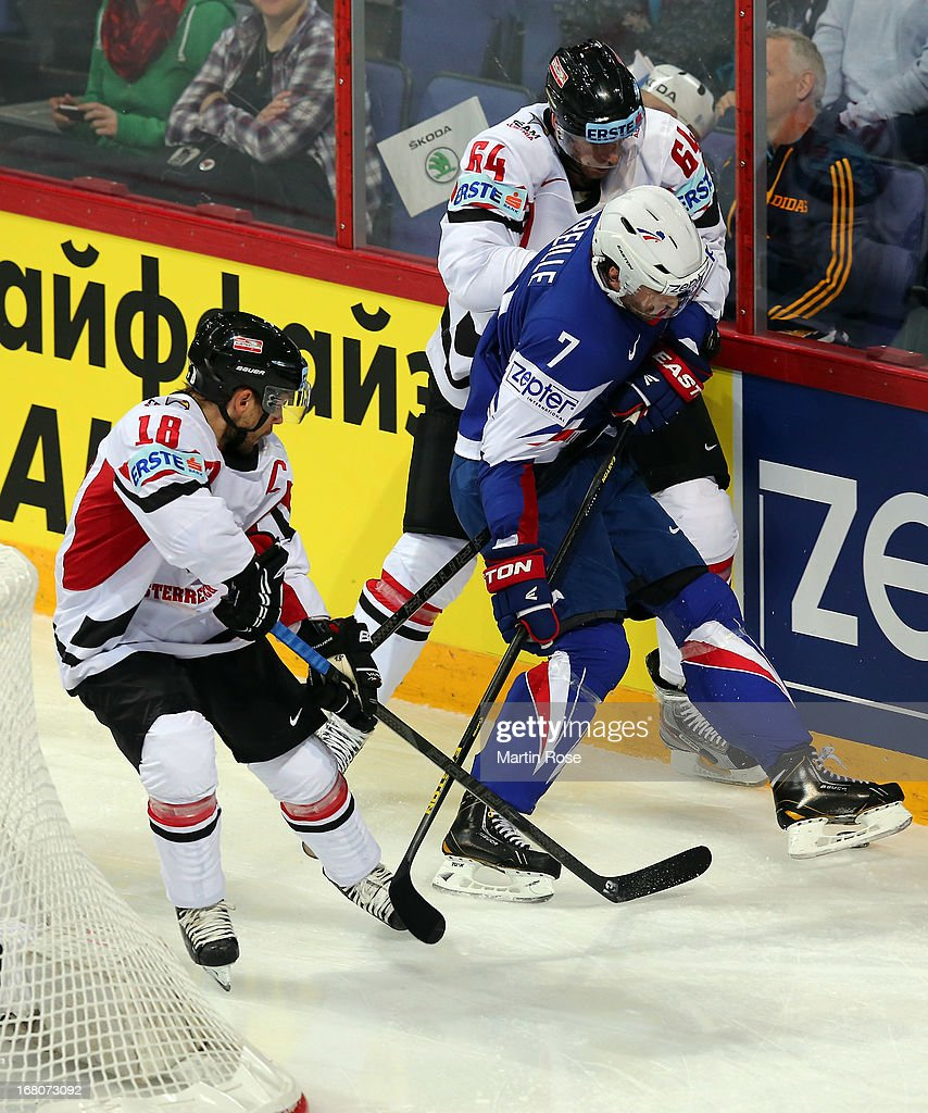 Yorick Treille (#7) of France and Ande Lakos (#64) of Austria battle for the puck during the IIHF World Championship group H match between France and Austria at Hartwall Areena on May 5, 2013 in Helsinki, Finland.