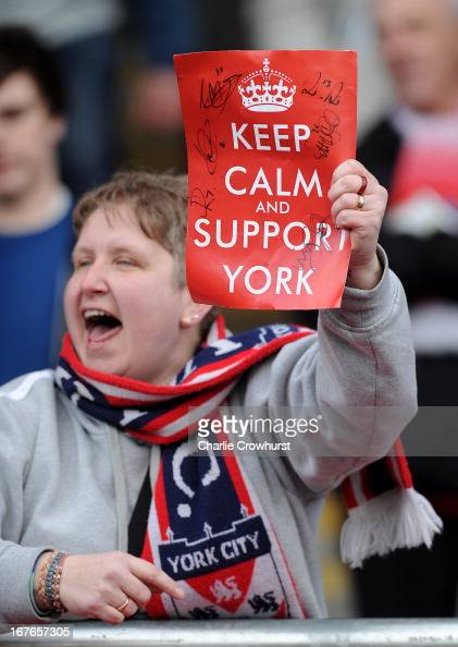 York City fan celebrates victory by holding up a poster saying 'keep calm and support York' during the npower League Two match between Dagenham and...