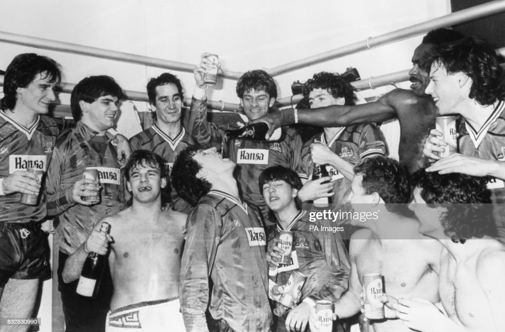 York City players celebrate their 1-0 victory in the dressing room after the match: (l-r) Alan Hay, Mike Astbury, Ricky Sbragia, John MacPhail, Sean Haslegrave, Keith Walwyn, Alan Pearce; (front row, l-r) Steve Senior, Keith Houchen, Martin Butler, Gary Ford, ?
