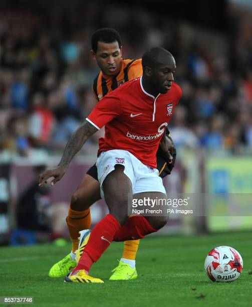 York City's Anthony Straker and Hull City's Ahmed Elmohamady battle for the ball during the PreSeason friendly at Bootham Crescent York