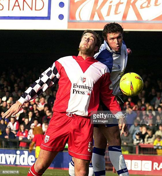 York City's Jon Parkin and Bury's Colin Woodthorpe challenge for the ball during their Nationwide Division Three match at York's Bootham Crescent...