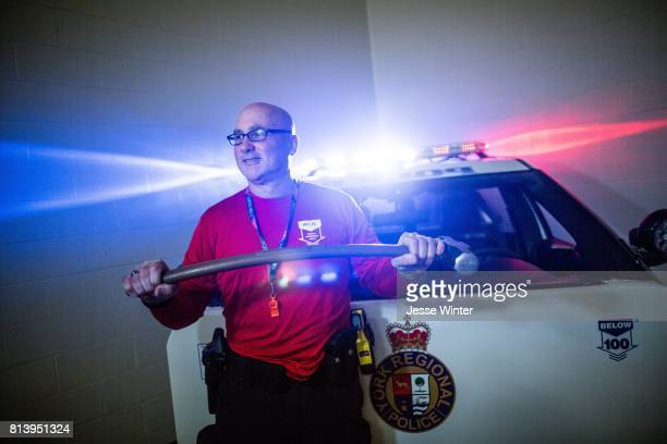 TORONTO ON JULY 12 York Regional Police Sgt Jeff Nolan shows off some of the service's rubber training weapons The tools are part of the services's...