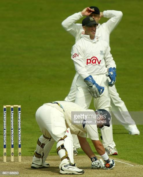 Yorkshire Batsman Darren Lehmann loses balance after a close call while Sussex Wicketkeeper Matt Prior looks on