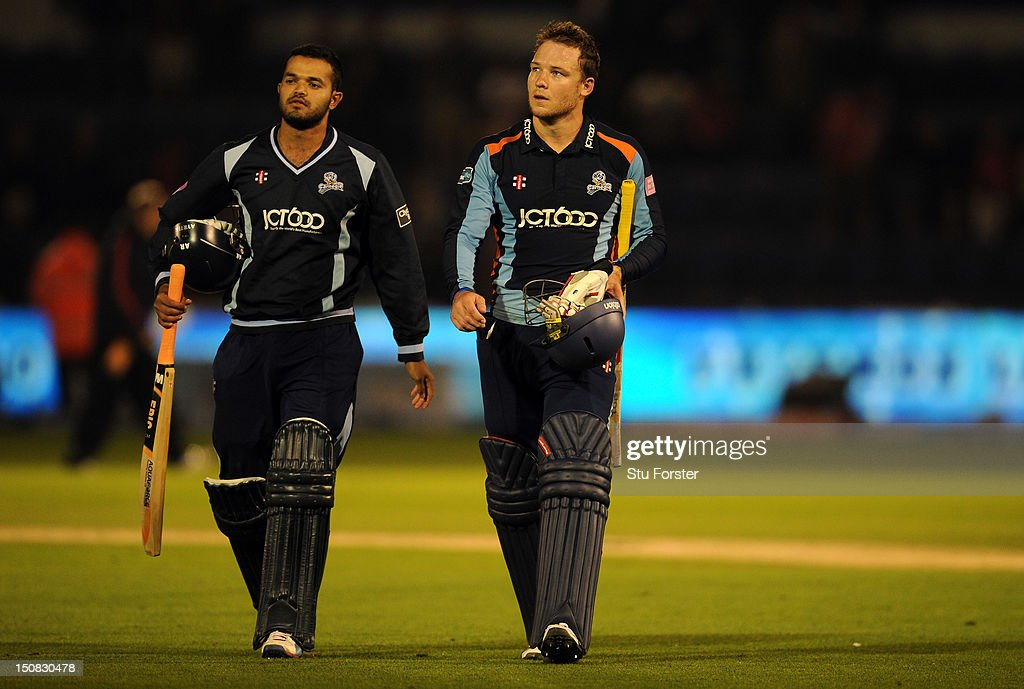 Yorkshire batsman David Miller (r) leaves the field at the end of the final of the Friends Life T20 between Hampshire and Yorkshire at SWALEC Stadium on August 25, 2012 in Cardiff, Wales.
