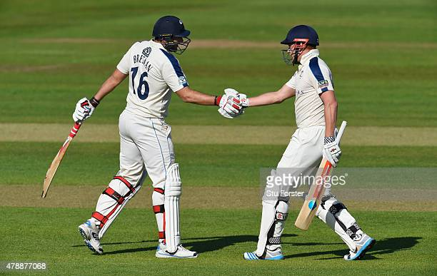 Yorkshire batsman Jonny Bairstow and Tim Bresnan celebrate their 100 partnership during day one of the LV County Championship Division One match...