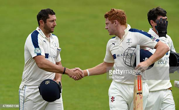 Yorkshire batsmen Tim Bresnan and Jonny Bairstow congratulate each other after coming off for lunch with their partnership unbeaten on 250 runs...